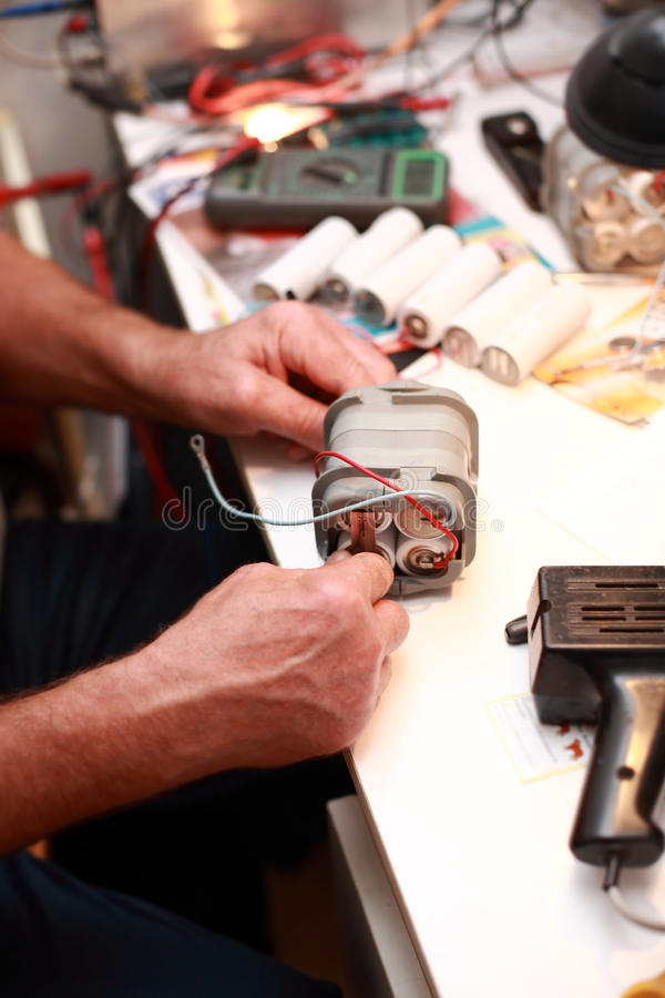 Senior electrician. Photo of senior electrician working - hands detail royalty free stock image