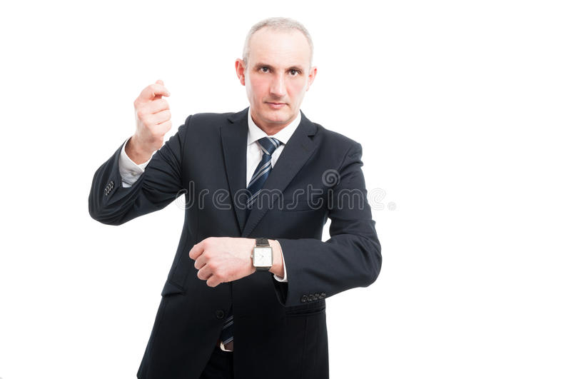 Senior elegant man showing wrist watch. Wearing suit and tie isolated on white background with copy text space royalty free stock images