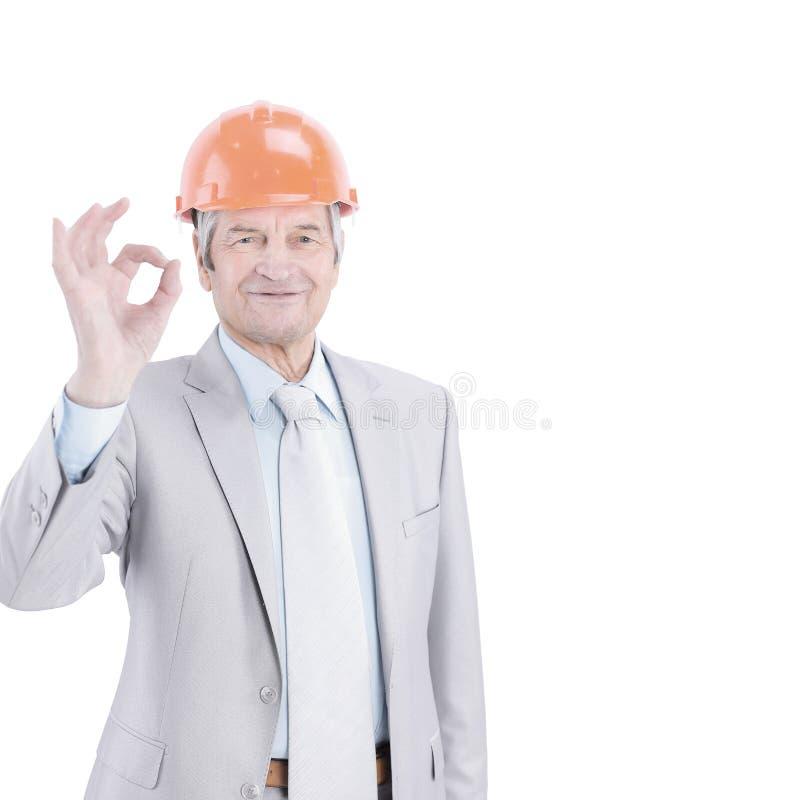 Senior engineer showing OK sign. isolated on white stock photo