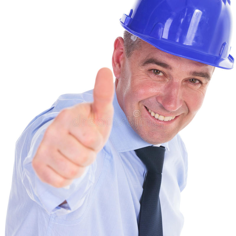 Senior engineer showing you the thumbs up ok sign. And smiling. isolated on white background stock photo
