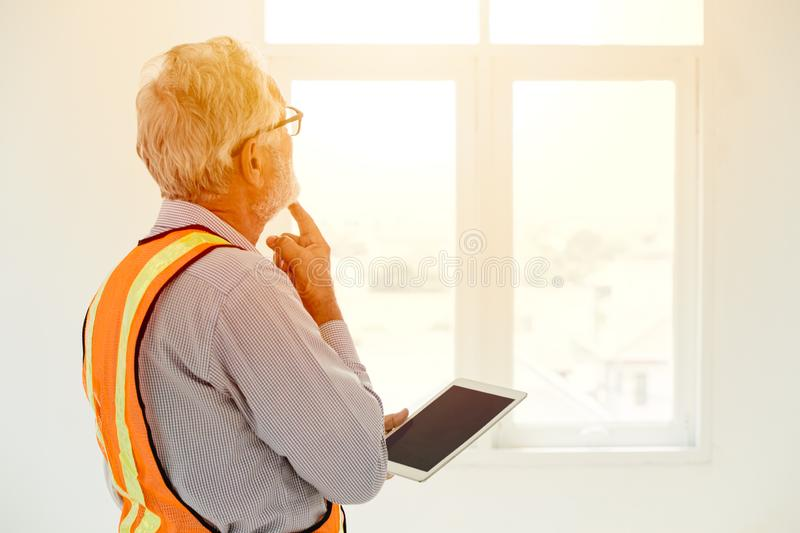 Senior engineer thinking project looking at windows royalty free stock photos
