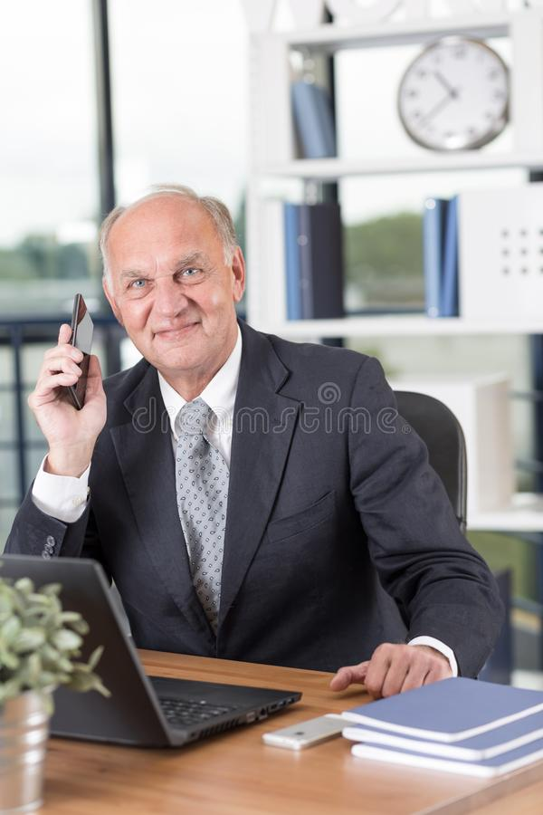 Senior entrepreneur working in office stock photography