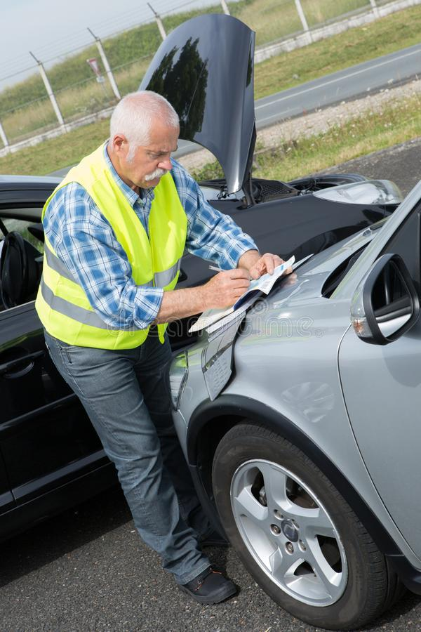 Senior establishing friendly report after trafic accident royalty free stock photo