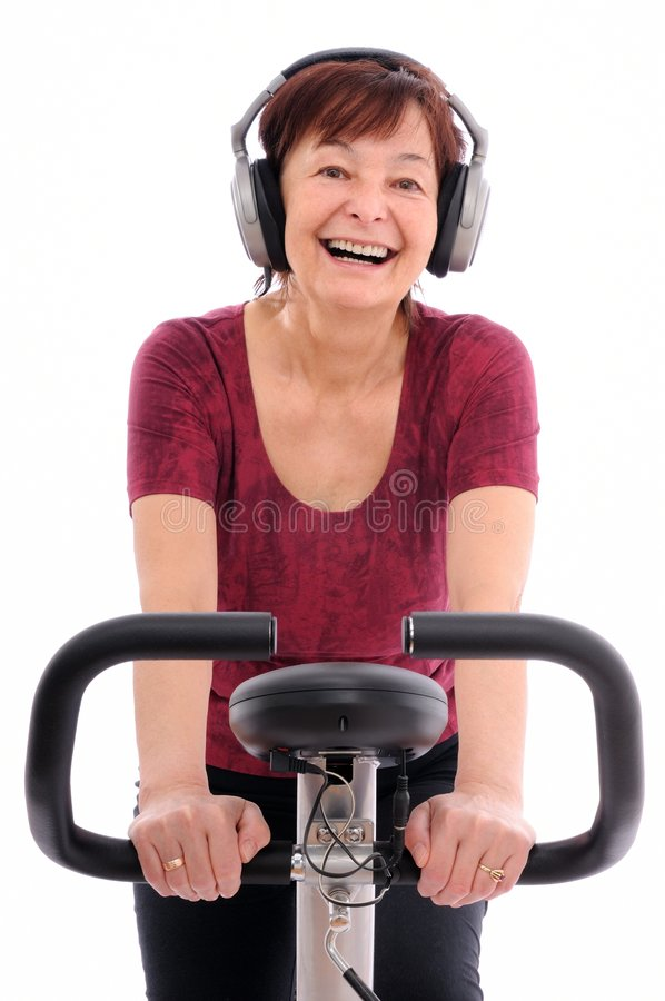 Senior excercising woman listens music royalty free stock images