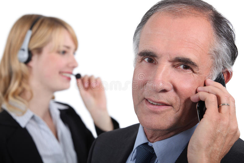 Senior executive with assistant stock photos