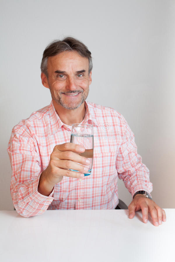 Senior executive business manager with a glass of water stock images