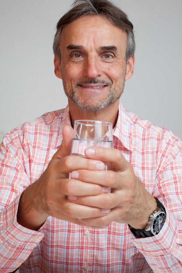 Senior executive business manager holding a glass of water royalty free stock image