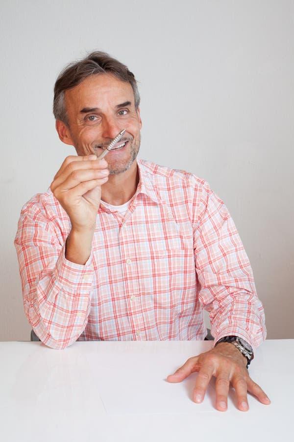 Senior executive business manager holding a pen stock photo