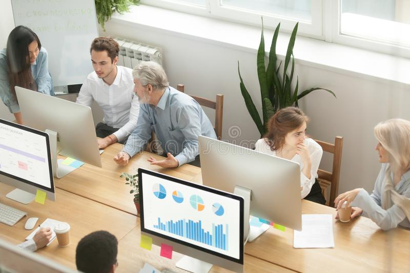 Senior executives teaching young employees in office, mentoring royalty free stock photos