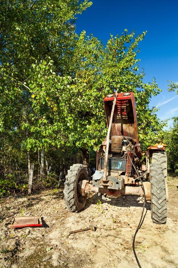 Download Senior Farmer Repairing His Tractor Stock Images - Image: 26778944