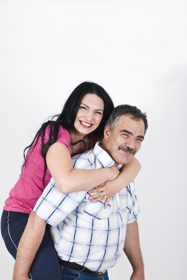 Senior father and adult daugher piggyback royalty free stock images