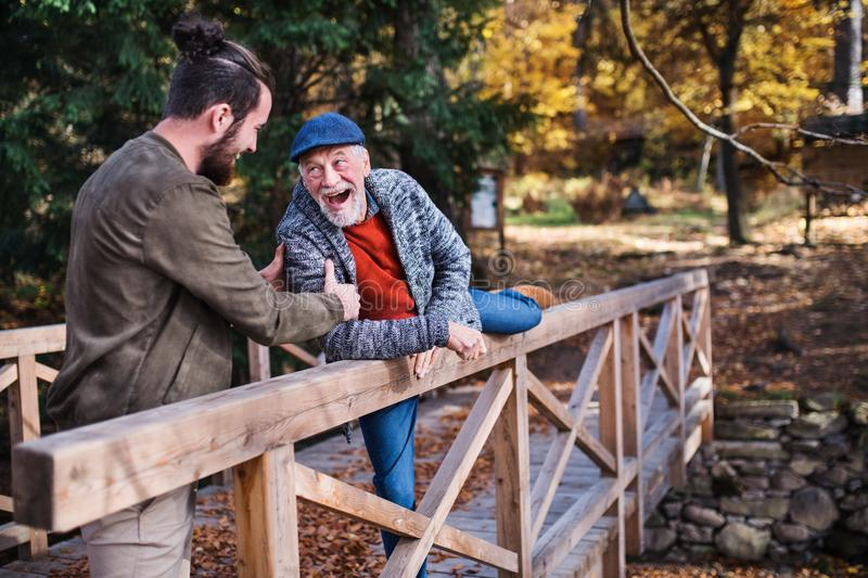 Senior father and his son walking in nature, having fun. stock photos