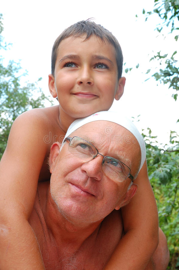Senior father with son. Senior father with his youngest son outdoor
