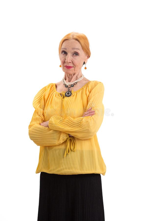 Senior female with crossed arms. stock photography