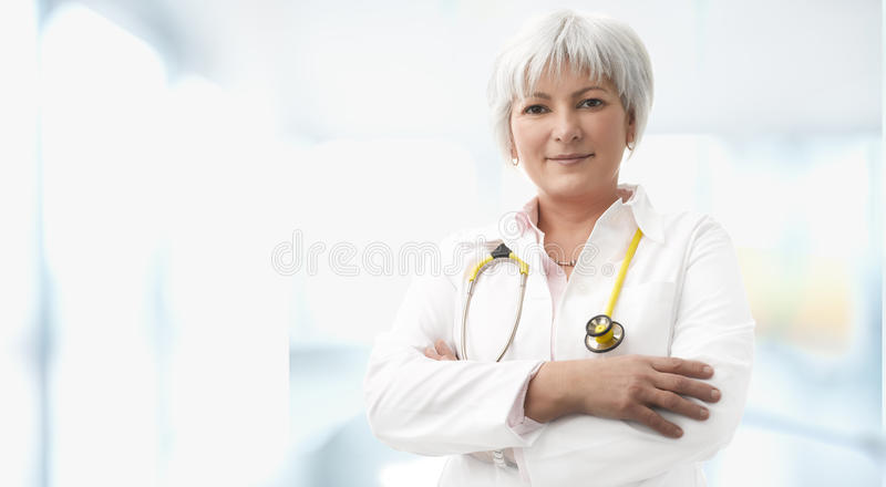 Download Senior Female Doctor stock photo. Image of facial, candid - 30405428