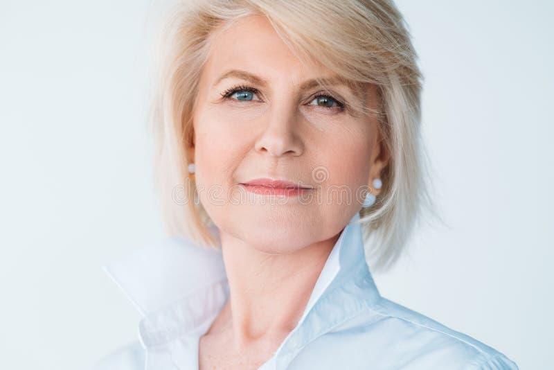 Senior female elegant personal style thoughtful royalty free stock photography