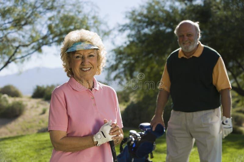 Senior Female Golfer Smiling royalty free stock images