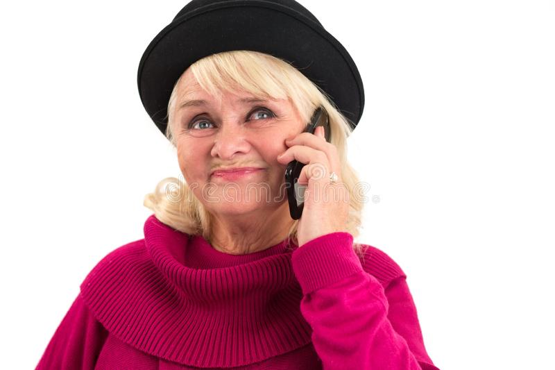 Senior female holding a cellphone. Woman with phone isolated. Commercial of mobile operator stock photos
