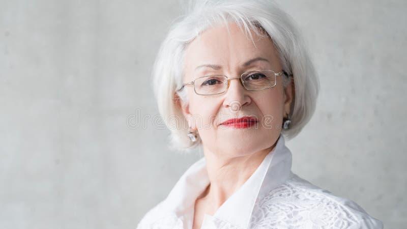 Senior female overconfident facial expression stock image
