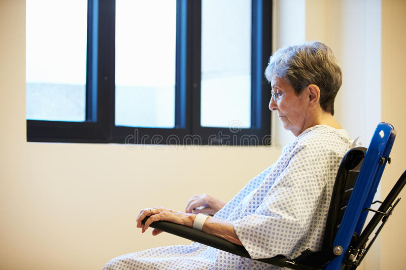 Senior Female Patient Sitting Alone In Wheelchair. Looking Sad royalty free stock images