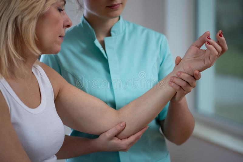 Female patient Working With young professional Physiotherapist stock images