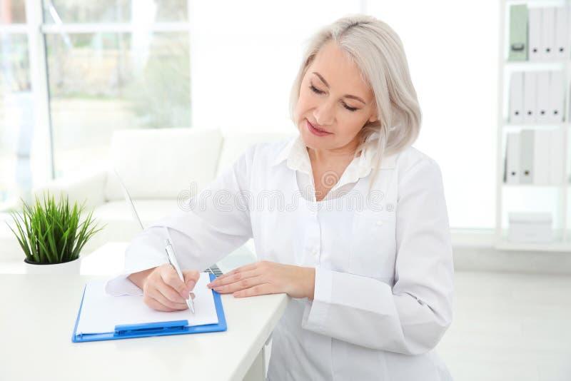 Senior female receptionist working stock image