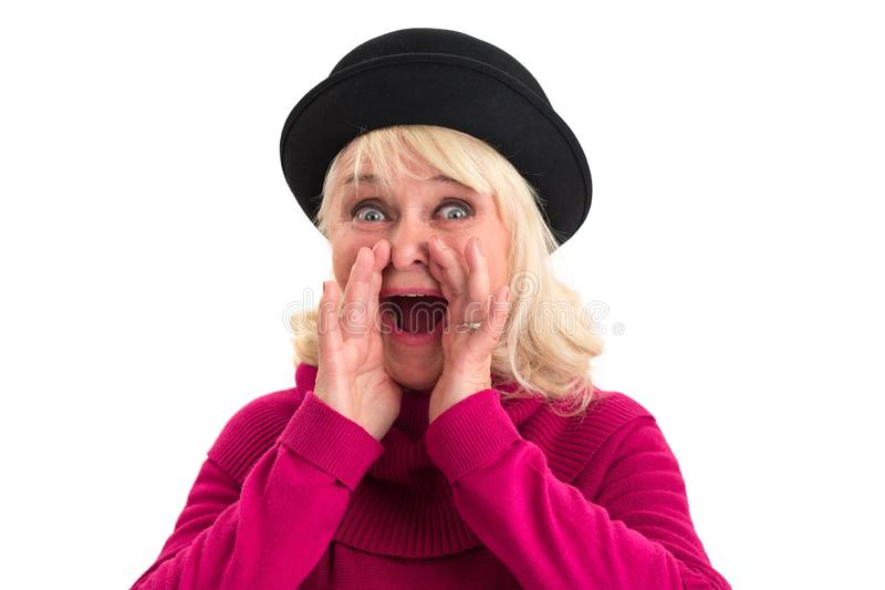 Senior female is shouting. Surprised old lady isolated. Break through the noise stock photos