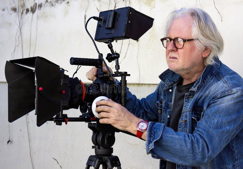 Senior filmmaker stock photography