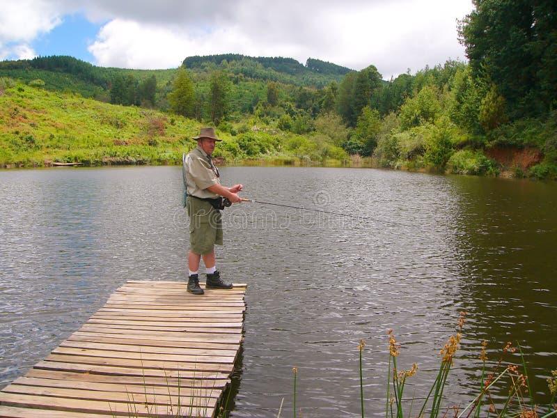 Senior fisherman fly-fishing
