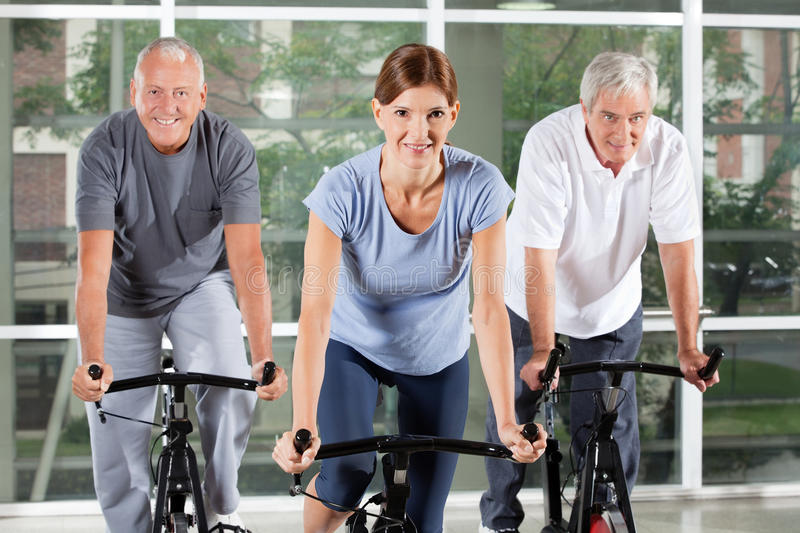 Download Senior Fitness Class In Gym Stock Image - Image of happy, center: 23965823