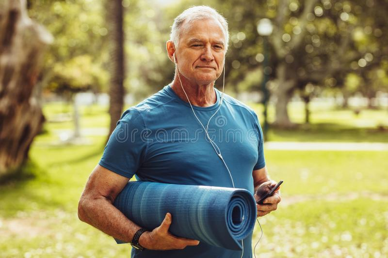 Senior fitness person walking in park royalty free stock images