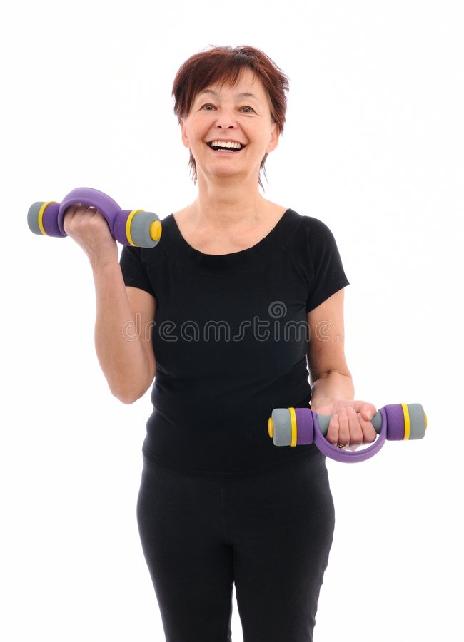 Senior fitness woman with barbells royalty free stock photography