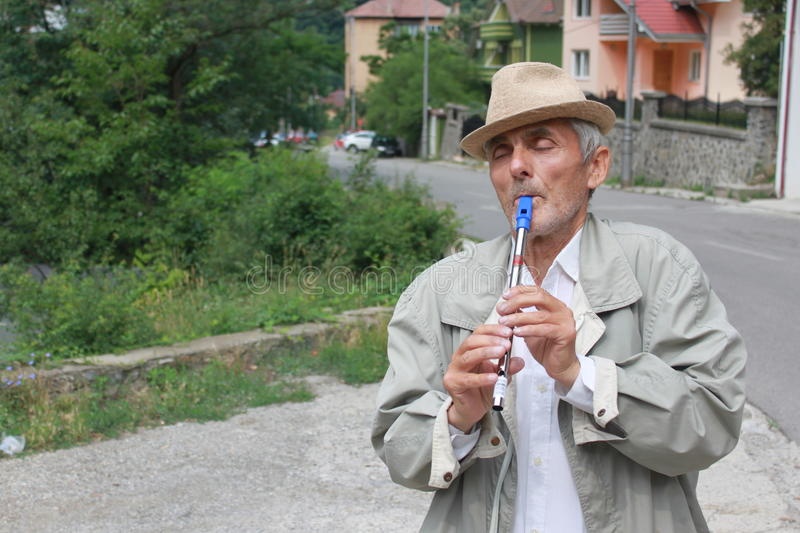 Download Senior with a flute editorial stock image. Image of instruments - 32260874