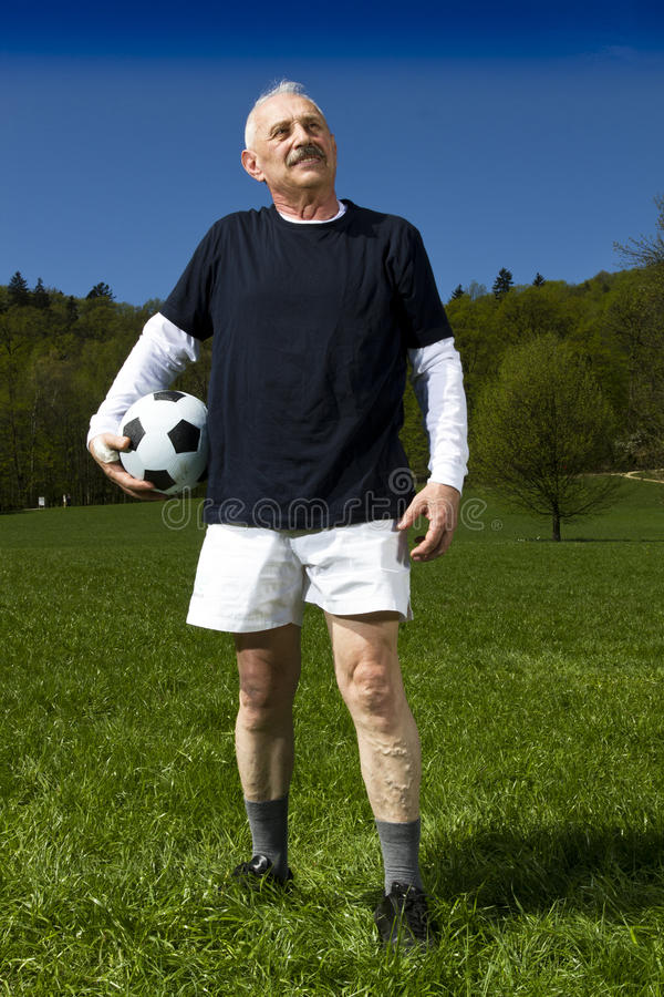 Senior football player stock images