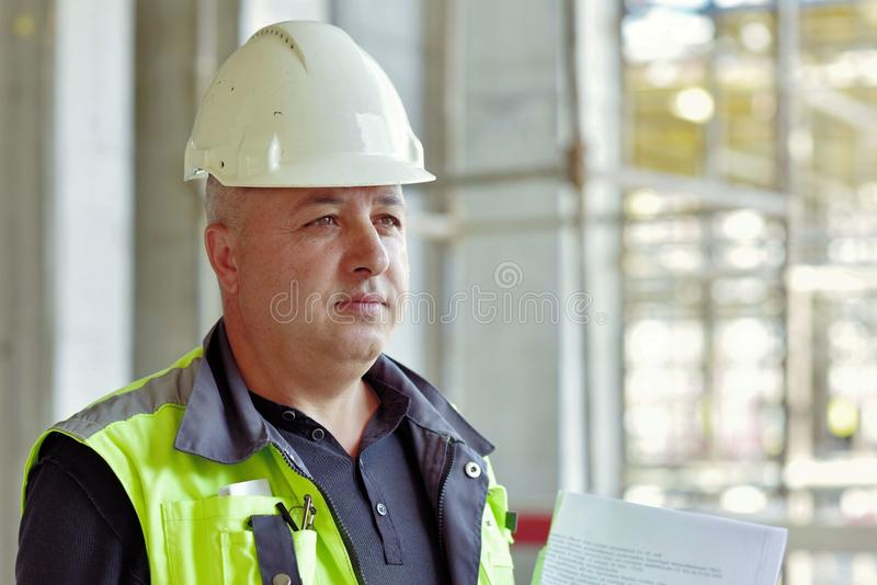 Senior Foreman At Construction Site. Close Up Portrait Of A Senior Foreman At Construction Site stock photography
