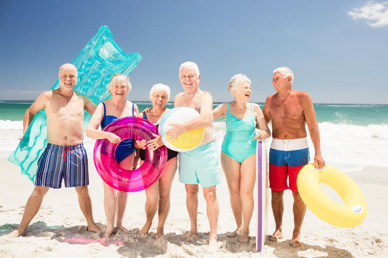 Senior friends with beach accessories stock image