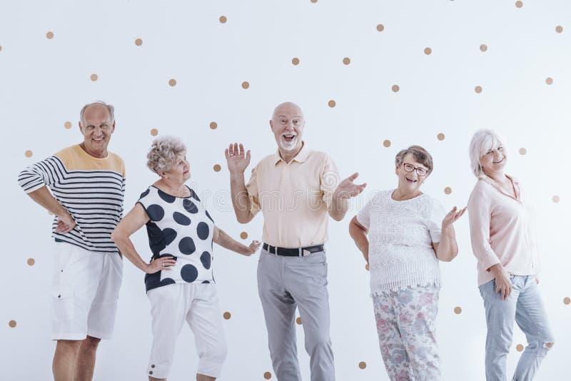 Senior friends celebrating birthday stock photo