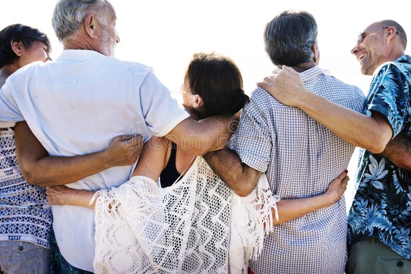 Senior friends chilling and hugging together stock image