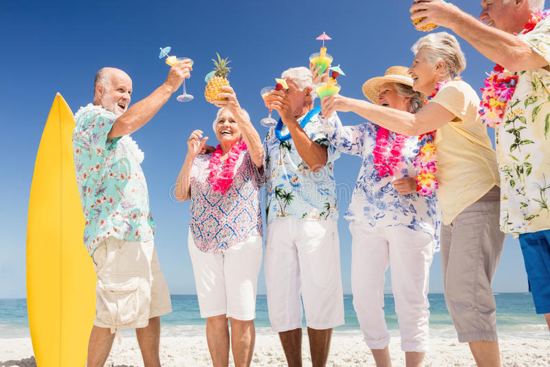Senior friends drinking cocktails stock photo