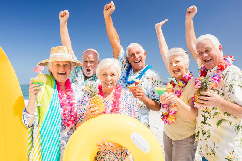 Senior friends drinking cocktails royalty free stock photos