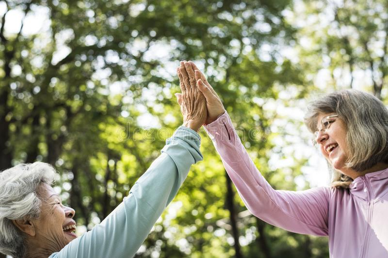 Senior friends exercising outdoors happily stock photography