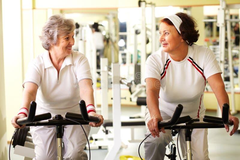Senior friends in gym stock photos