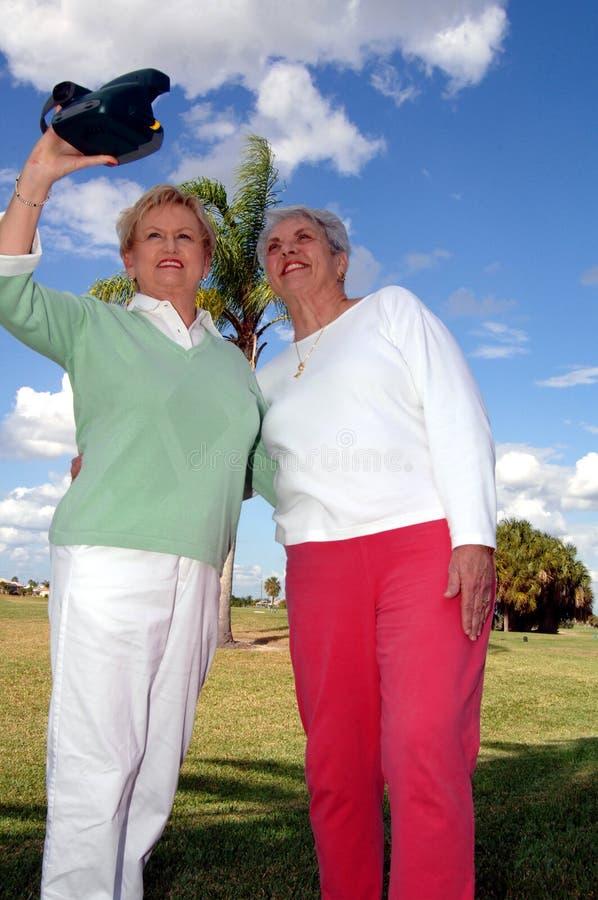 Senior friends taking photo stock photos