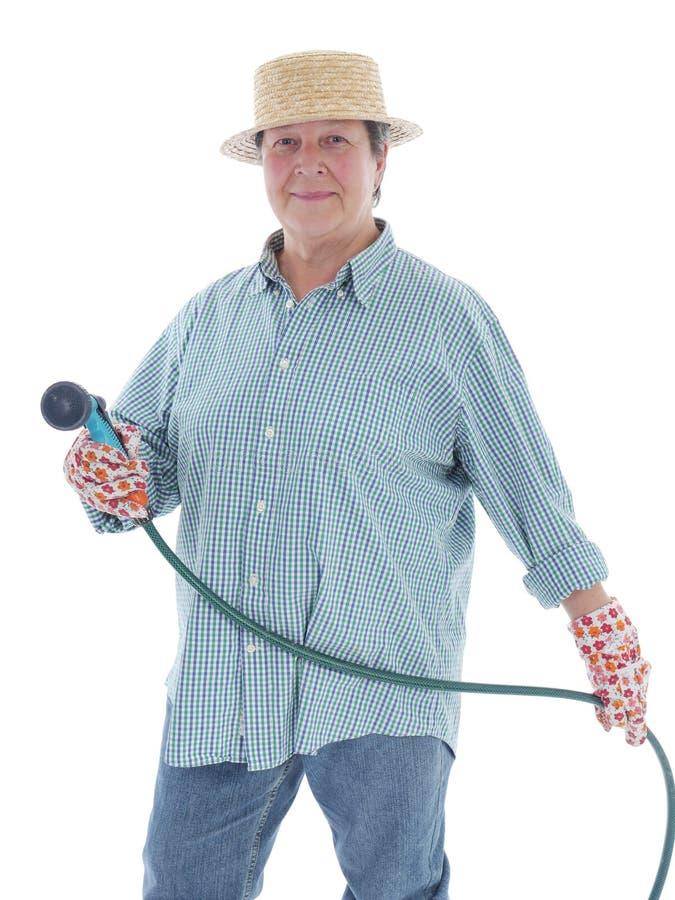 Senior Gardener With Hose Stock Image