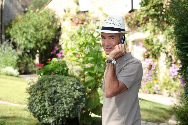 Download Senior Gentleman Making A Call Stock Image - Image: 33504875
