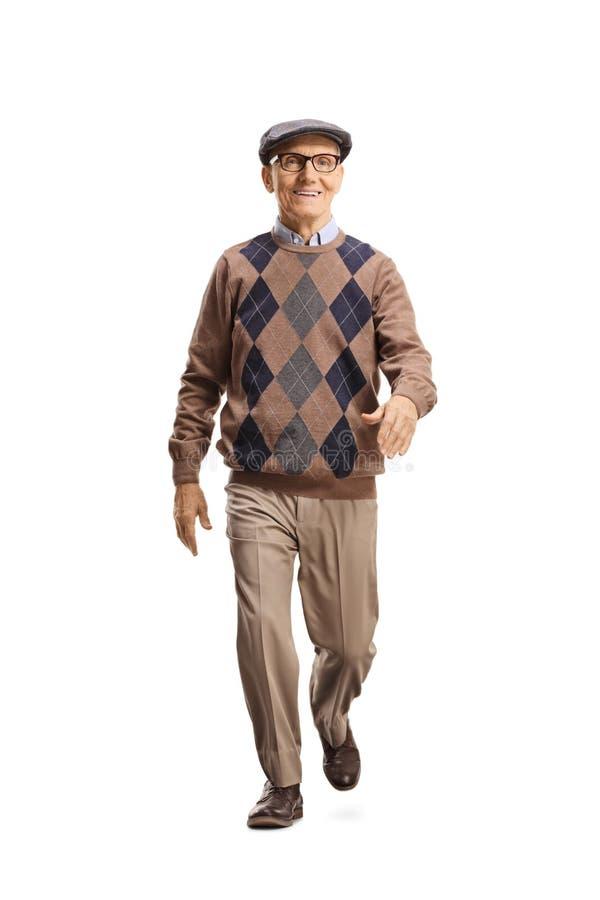 Senior gentleman walking towards the camera stock images