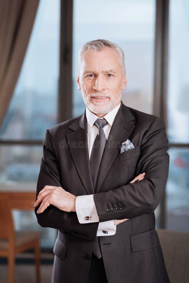 Senior glad man staying calm stock images