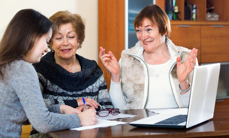Senior glad women making will at public notary office royalty free stock photography