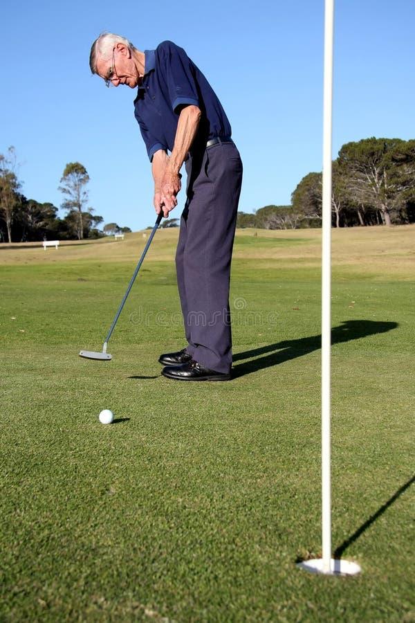 Senior Golf Putter royalty free stock images