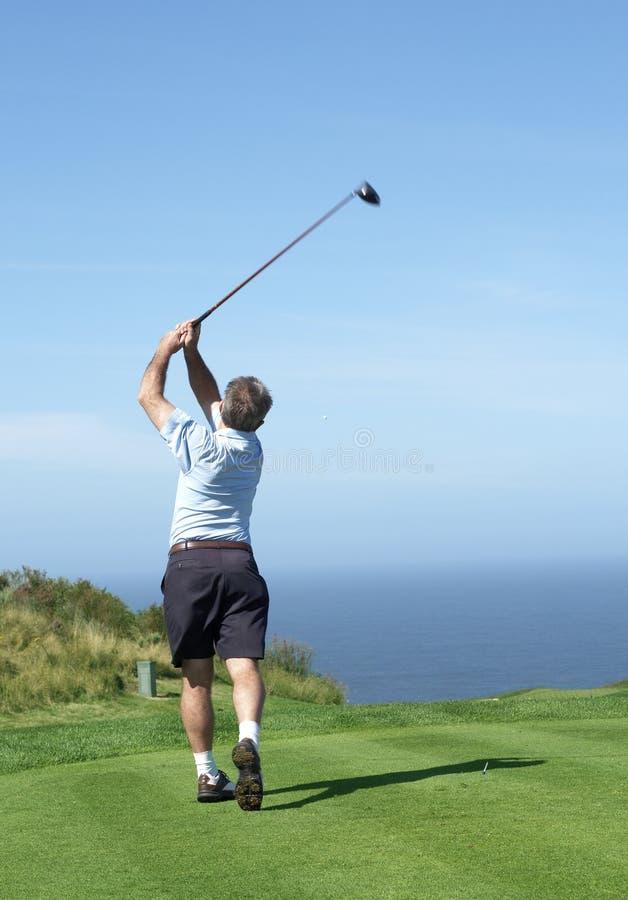 Senior golfer playing golf stock photos